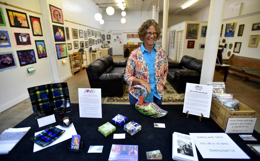 Mardy Bogar smiles as she stands in Upcountry Artists Gallery and Learning Center on Friday in Farmington. The gallery is closing at the end of April.