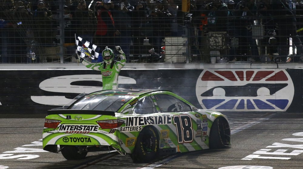 Kyle Busch celebrates after winning the NASCAR Sprint Cup Series auto race early Sunday morning at Texas Motor Speedway in Fort Worth, Texas.