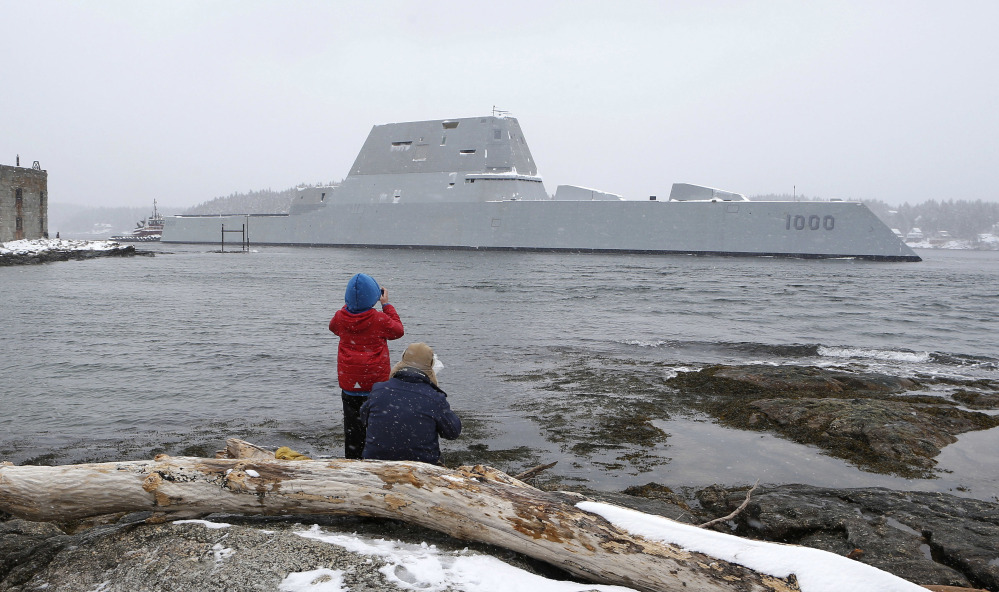 In this March 21 photo Dave Cleaveland and his son, Cody, photograph the USS Zumwalt as it passes Fort Popham at the mouth of the Kennebec River in Phippsburg, as it heads to sea for final builder trials. The ship is so stealthy that the U.S. Navy resorted to putting reflective material on its halyard to make it visible to mariners during the trials.
