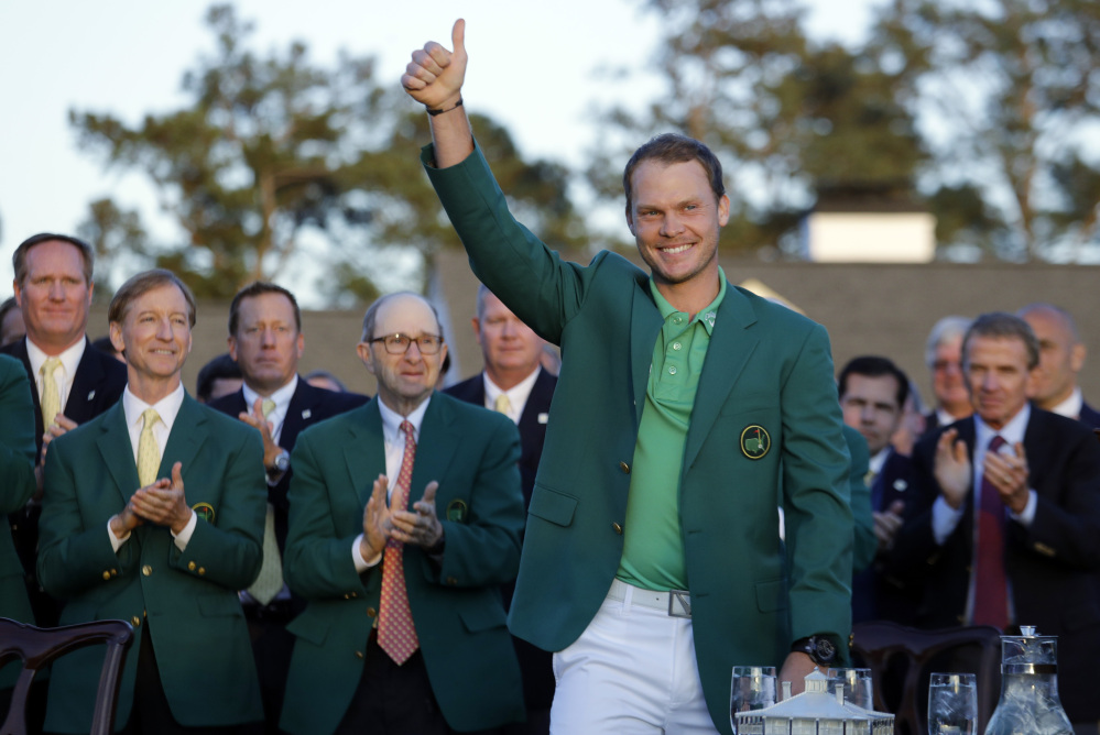Masters champion Danny Willett gives a thumbs up after winning the Masters on Sunday in Augusta, Georgia.