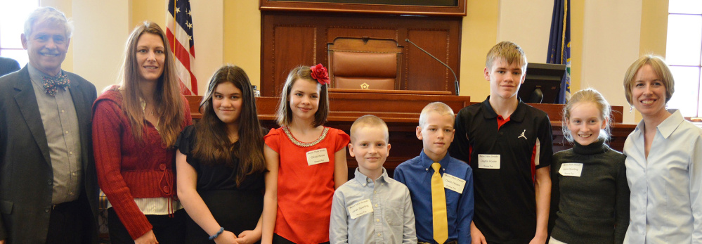 A group of homeschool students from Fayette were welcomed March 29 to the State House by Sen. Tom Saviello, R-Wilton. The students served as Honorary Pages for the day's legislative session, delivering documents and messages to senators and assisting the chamber staff with their daily duties. From left, are Saviello, Charity House, Natalie House, Olivia House, Jonah Sparling, Owen House, Clayton House, Jaina Sparling and Molly Sparling.