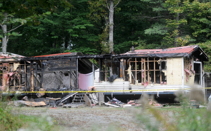 A Canaan man charged with arson in a September fire that destroyed a mobile home in Canaan and killed several pets is facing new charges.