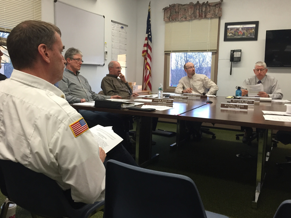 Fire Chief Terry Bell sits in front of the Farmington Board of Selectmen on Tuesday night as the board decides to postpone the hiring of two full-time firefighters because a nepotism clause in the town's hiring policy makes them ineligible.