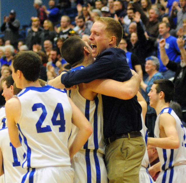 Staff file photo by Joe Phelan Valley coach Luke Hartwell celebrates with his players after the Cavaliers beat Easton in the Class D state championship game on Feb. 27 at the Augusta Civic Center. Hartwell recently resigned, the school announced Wednesday.