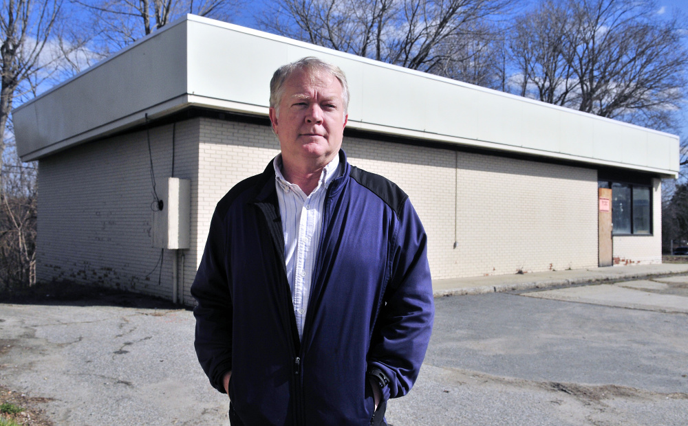 Kevin McCarthy, vice president of Copy Center Plus, stands in front of at 179 State St. in Augusta, which he plans to turn in to a copy center.
