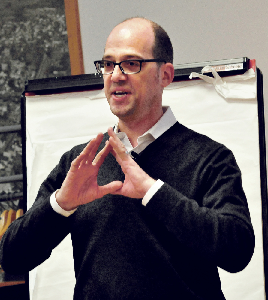 Neil Kittredge leads a strategy discussion Wednesday on downtown revitalization in Waterville.
