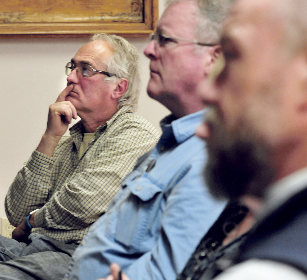 Waterville Concourse business owner Ken Vlodek, left, listens to a discussion Wednesday about revitalization of downtown Waterville.