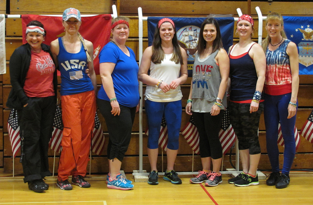 Seven instructors lead Zumba-Thon participants, included, from left, Monica Gilbert Beach, Carol Later-Carl, Lisa Berry, Katie Bussiere,  Hillary White, Tiara Nile, organizer; and Suzanne Lamb.