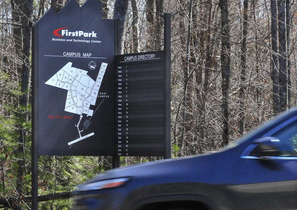 A motorist passes a FirstPark directory sign Thursday at the business park in Oakland. The park is aiming to attract small and medium-sized companies to its remaining lots while a global real estate firm works to identify developers to construct buildings there.