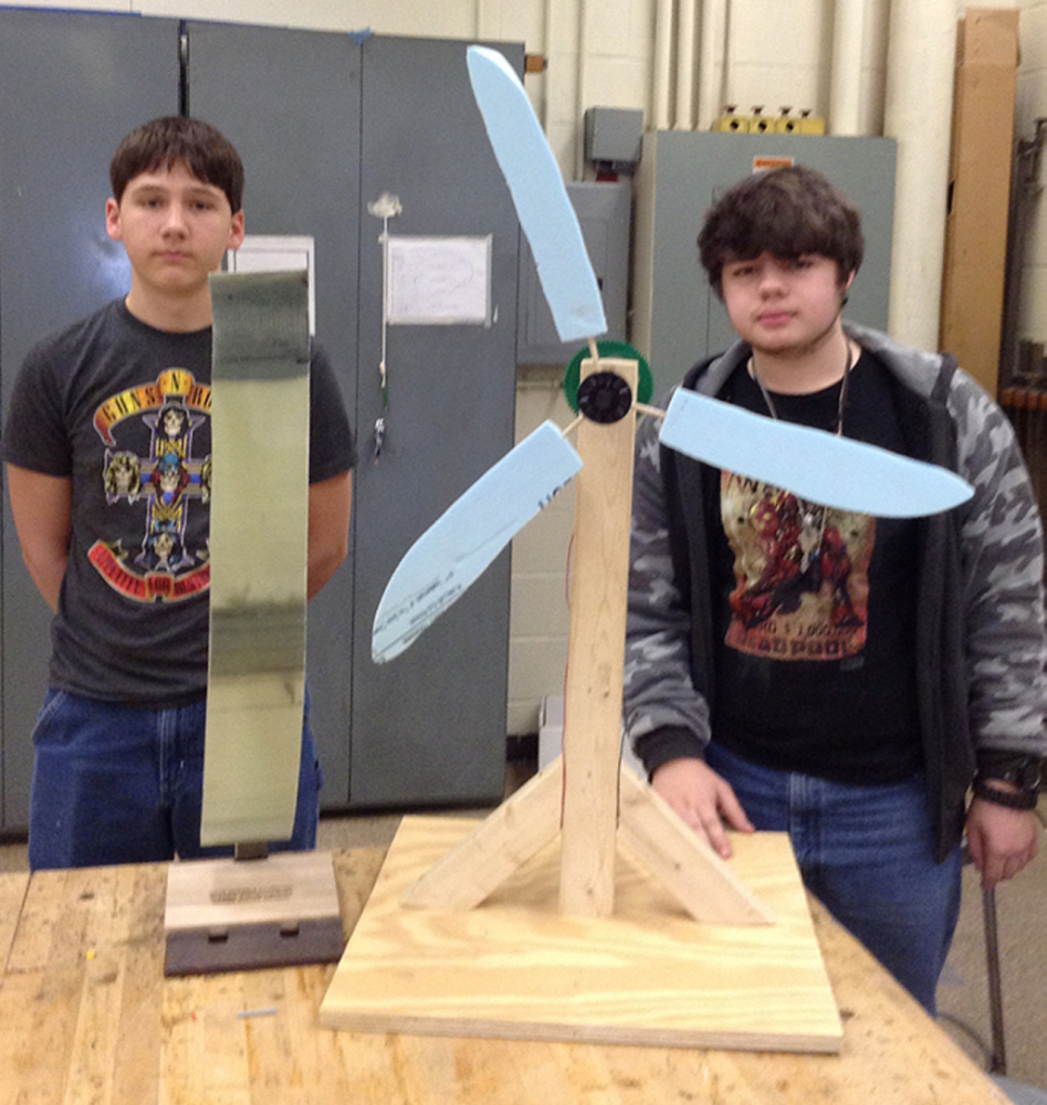 The Winslow team of Ross Hughes, left, Micah Dickson placed first, earning them the chance to compete at the National Kid Wind Challenge, to be held at the American Wind Energy Association's Windpower Conference this May in New Orleans. Micah and Ross had designed blades from insulating foam board and a gear train for power generation. They also created a presentation to document their design process and knowledge of wind power.