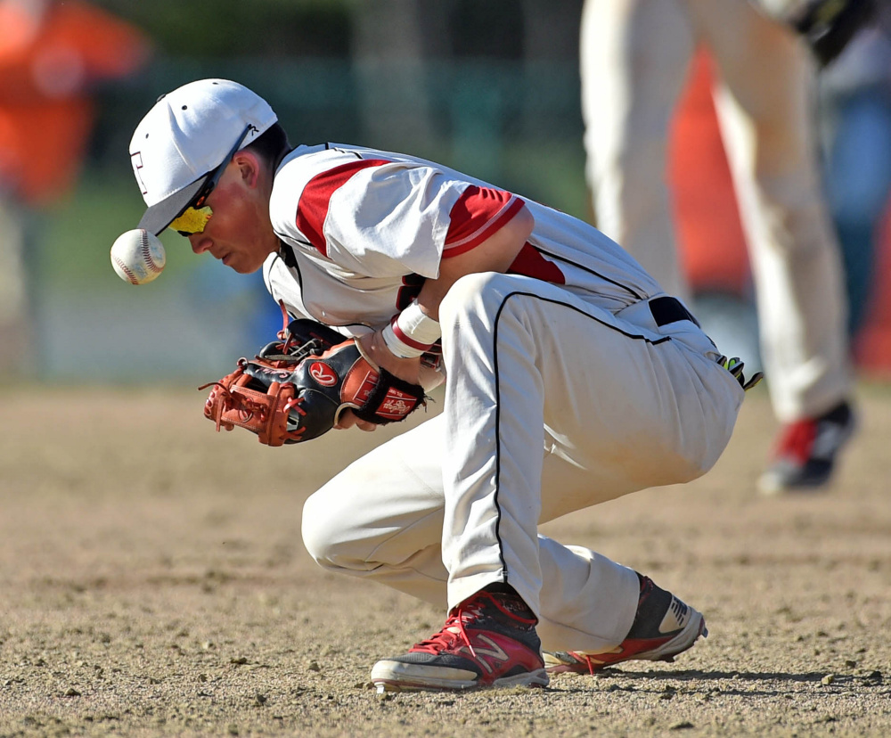 Thomas College second baseman Aron Smestad gets eaten up by a groundball against New England College on Saturday at Thomas College in Waterville.
