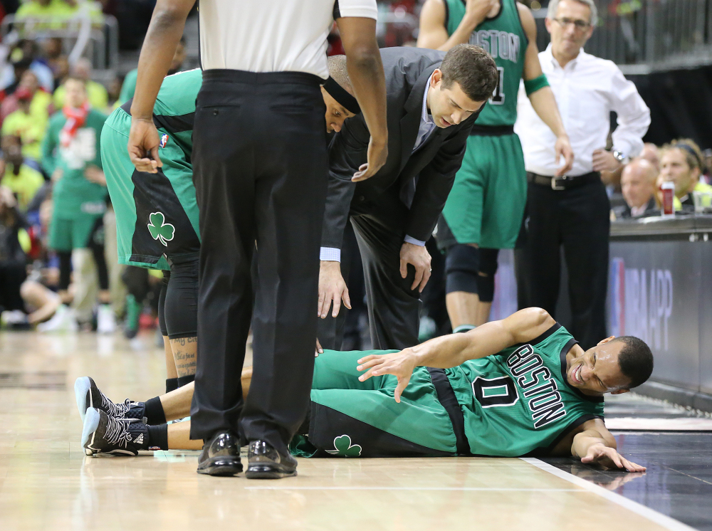 Boston Celtics guard Avery Bradley goes down to the hardwood during Game 1 against the Atlanta Hawks in a first-round NBA playoff series Saturday in Atlanta.