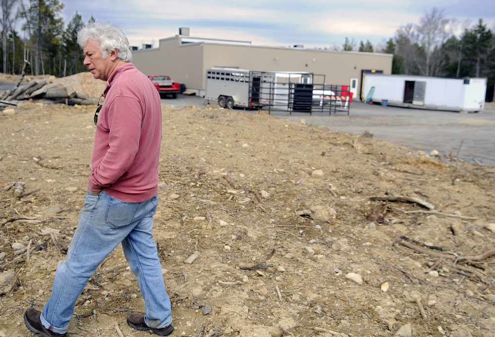 Central Maine Meats partner Joel Davis walks to what he plans to develop as pens for the firm's slaughterhouse in Gardiner on Monday.