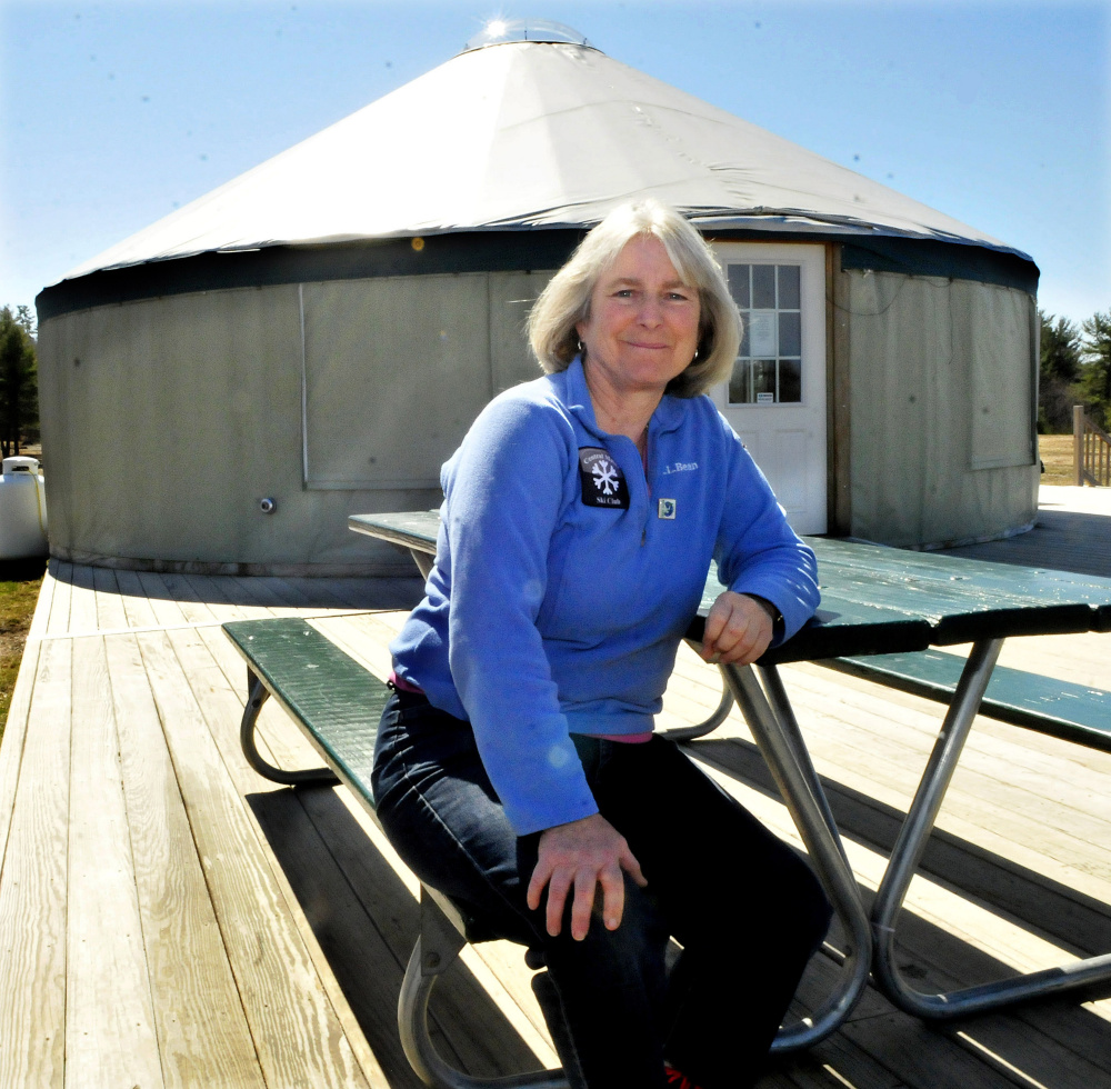 Caroline Mathes sits outside the welcome yurt at Quarry Road Recreation Area in Waterville, which has been named the Community Service Project of the Year by the Mid-Maine Chamber of Commerce.