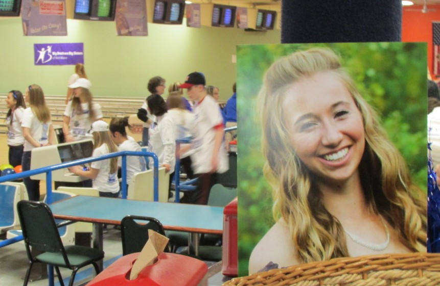 Bowlers take to the lanes last year in a Bowl for Cassidy's Sake fundraiser that raised $36,000 for Big Brothers Big Sisters. Cassidy Charette, seen in foeground photo, was about to become a Big Sister when she was killed in a hayride accident in October 2014. Big Brothers Big Sisters plans to present a posthumous award to her Saturday at the REM Awards 2016, recognizing the community volunteer effort that has blossomed in her memory.