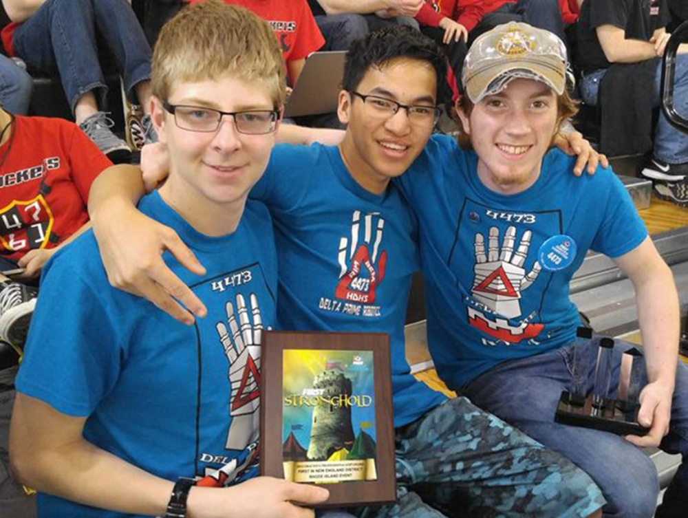 Hall-Dale High School's REM Delta Prime Robotics team members Isaac Lawrence, Ean Smith, and Colt Siegars celebrate after winning the Gracious Professionalism award at a FIRST robotics competition in Providence, Rhode Island, in March.