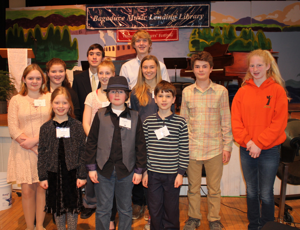 The 2016 Young Composers Competition & Festival attendees, front from left, are Maya Falstich, Logan Peters and Silas Bartol; middle, from left, are Amie Giles, Rachel Whitmore, Anikka Reinwand, Cameron Stewart and Alexandria Mason; and back, from left, are Samantha Dudley, Hayden Stacki and Soren Nyhus.