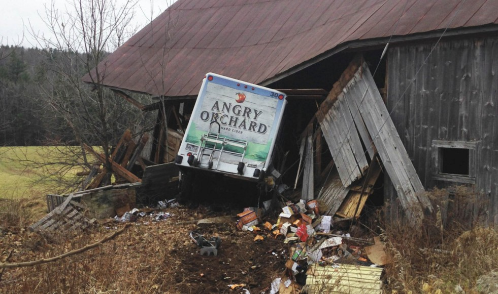 Nicole Dyment has been accused of crashing this stolen Angry Orchard delivery truck into the side of a barn in December 2015 in Limerick.