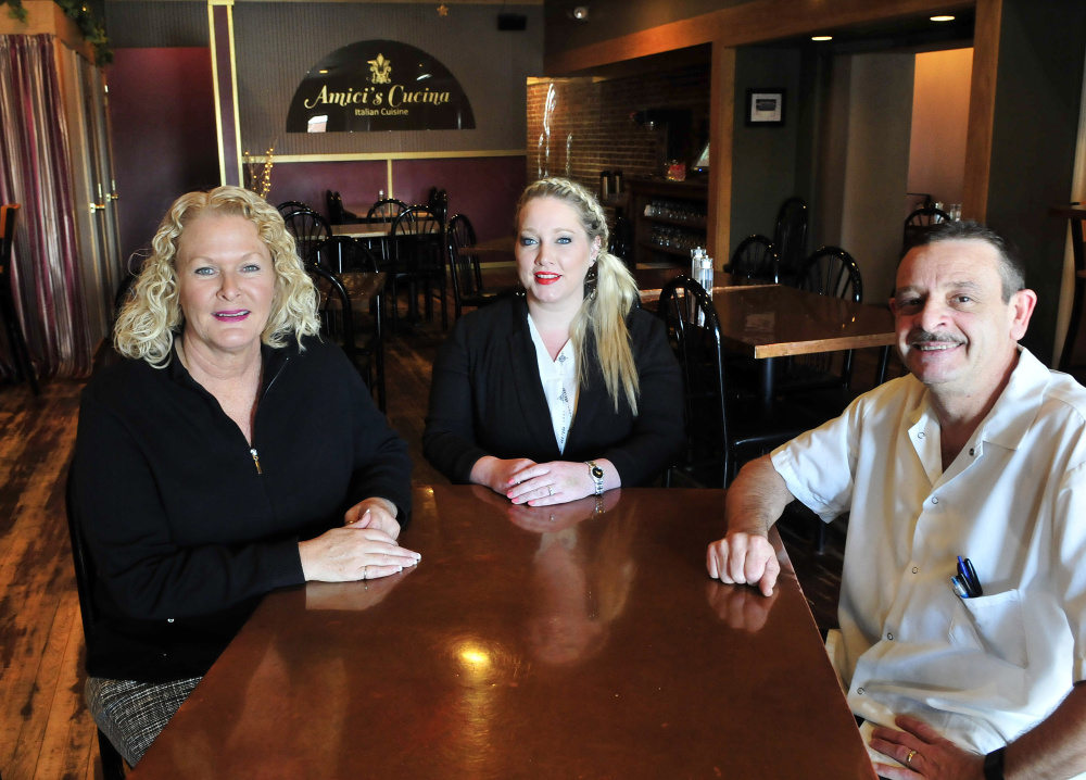 Downtown Waterville restaurant Amici's Cucina has been named Business of the Year by the Mid-Maine Chamber of Commerce. From left are owners Mary Carpinito, Shannon Mitchell and Angelo Carpinito.