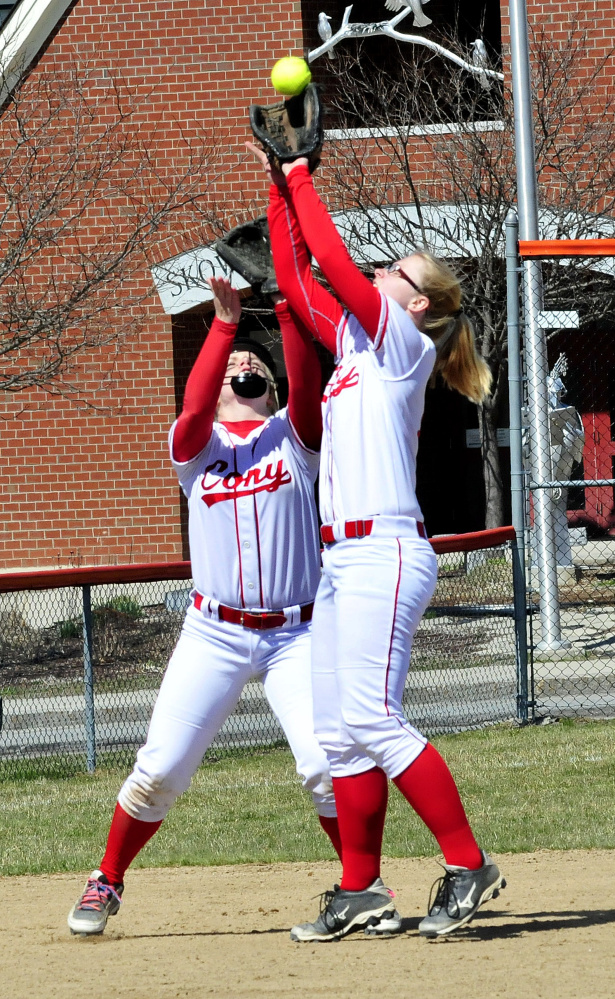 Cony's Alexis Couverette, left, and Autumn Sudsbury field a fly ball against Skowhegan on Wednesday in Skowhegan. Sudsbury made the catch.