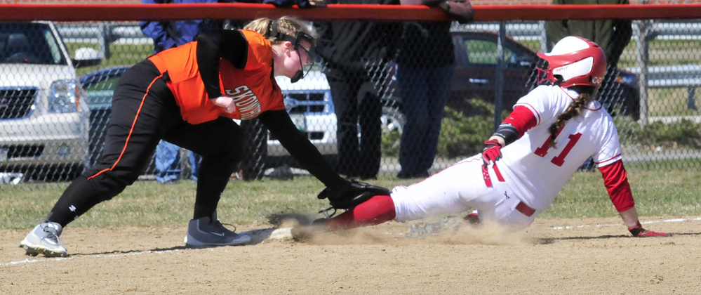 Skowhegan's Bonnie-Jane Aiken makes the tag on Cony's Skylar Watson at third base Wednesday in Skowhegan.