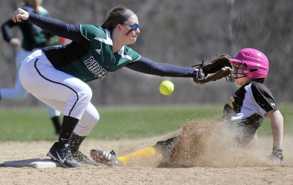 Maranacook's Justine Merrill slides under the attempted tag by Spruce Mountain's Haley Turcotte at second base during a softball game Wednesday in Readfield.