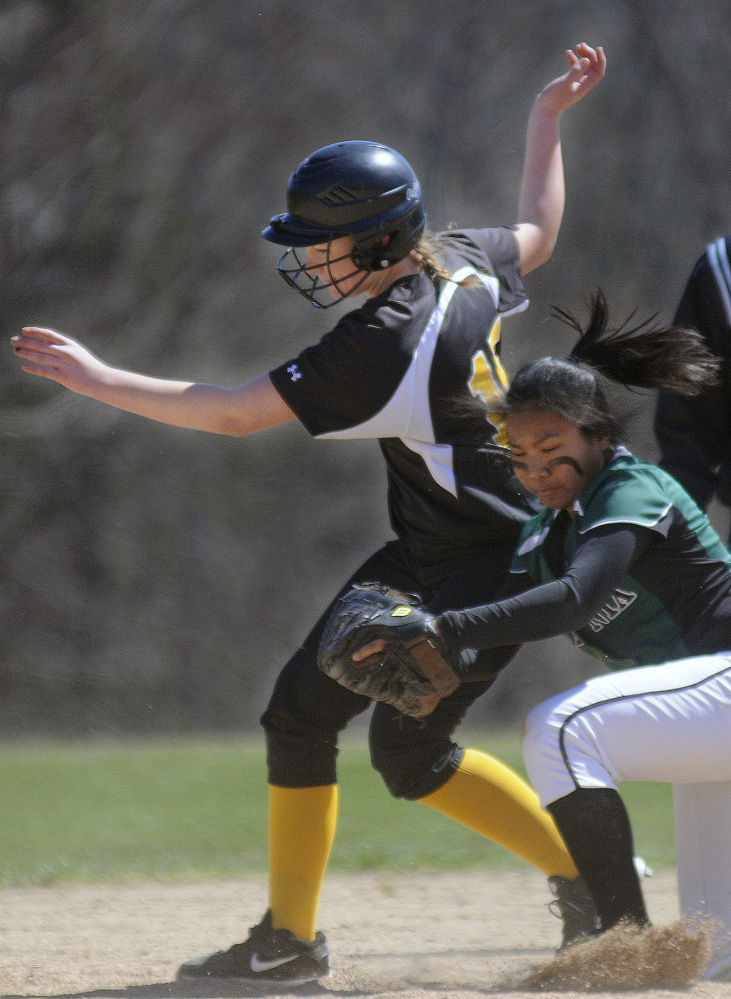 Maranacook's Sierra Weaver, left, collides with Spruce Mountain's Grace Ryan at second base during a softball game Wednesday in Readfield.