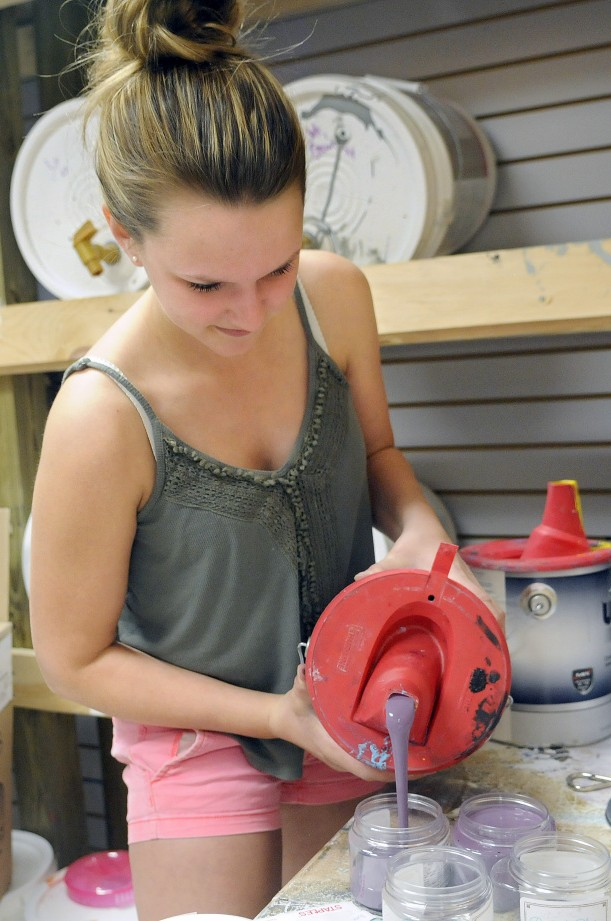 Abby Hoffay pours paint into jars Thursday at Chalky & Co. in Monmouth.