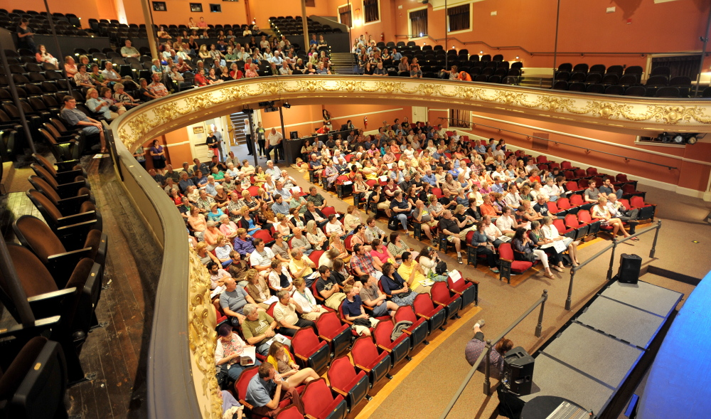 People take their seats in July 2014 for the opening night for the Maine International Film Festival at the Waterville Opera House. Both the Opera House and the Maine Film Center are among those who will share $510,000 from Waterville Creates!