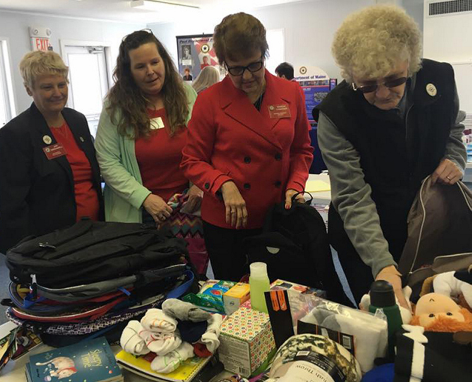 American Legion Auxiliary, Department of Maine hosted National President Sharon Conatser April 8-9 during a stopover in her year-long nationwide tour to call on community members. National President Sharon Conatser, second from right, helped members of the Maine American Legion Auxiliary pack 64 backpacks for the Maine Foster Kids program. From left are Past National Chaplain Jeri Greenwell, of Bethel; State Children and Youth Chairwoman Virginia Chaput, of Bath; Conatser, and Athens Auxiliary Unit 192 President Linda Doiron.