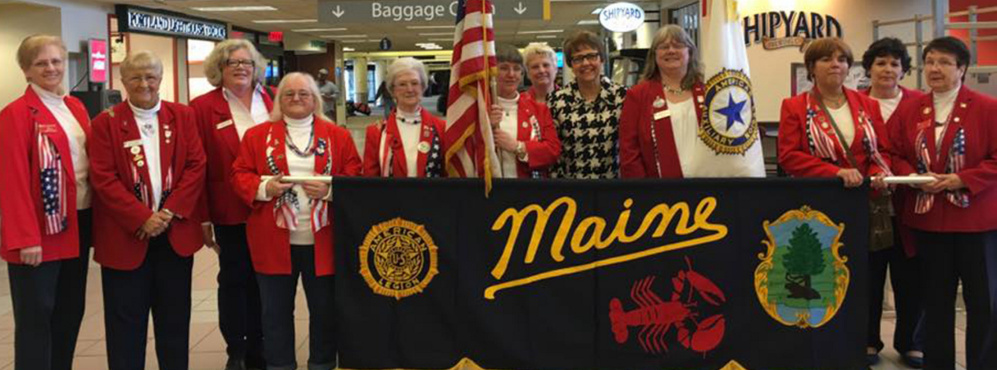 American Legion Auxiliary, Department of Maine hosted National President Sharon Conatser April 8-9 during a stopover in her year-long nationwide tour to call on community members. Several members of the Maine American Legion Auxiliary greeted National President Sharon Conatser upon her arrival at the Portland Jetport. From left are Mary Jane McLoon, Elizabeth Seeley, State President Debra Ann Marr, Linda Roberts, Theresa Owen, Charlotte Doyle, Jeri Brooks Greenwell, Conatser, Ann Durost, Pam Johnson, Joan Caron and Nancy Ronco.