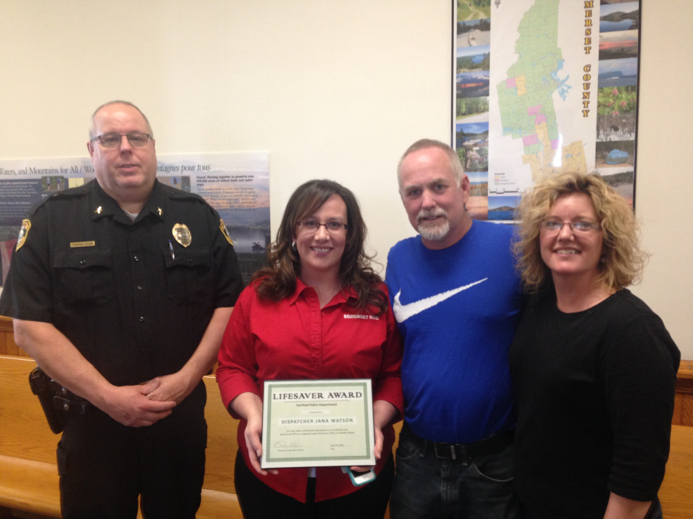 Fairfield police Chief Thomas Gould, left, presented dispatcher Jana Watson with a Lifesaver Award for her quick action over the phone Feb. 6 while instructing Kathleen Hill, far right, in using CPR to save the life of her husband, Troy Hill.