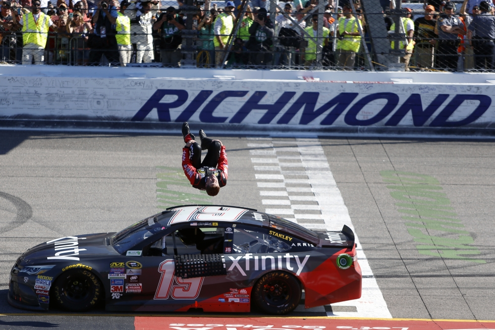 Carl Edwards does a back flip off his car after winning the Sprint Cup race at Richmond International Raceway on Sunday in Richmond, Virginia.