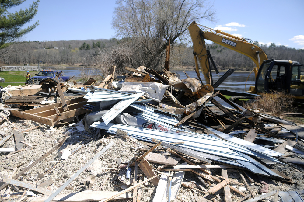The remnants of the house at 226 Water St. in Hallowell, where Canty Construction and Riverside Disposal razed the structure for owner Steve Hammond following a lengthy appeal process.