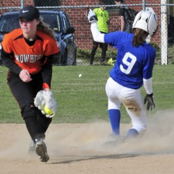 Skowhegan infielder Wylie Bedard fields ball as Messalonskee runner Madisyn Charest slides safely into second base during a Kennebec Valley Athletic Conference Class A game Monday afternoon.