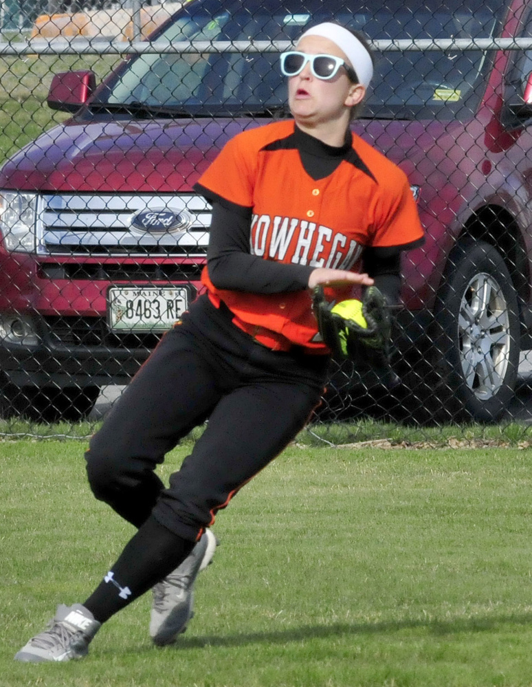 Skowhegan's Annie Worthen hauls in a fly ball during a Kennebec Valley Athletic Conference Class A game Monday afternoon against Messalonskee.