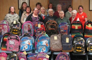 Members of the American Legion Auxiliary Unit 39 from Madison recently filled  20 backpacks as part of the Children and Youth Month observance by the American Legion Auxiliary. In front, from left, are Nancy Misiaszek, Kathleen Randall, Sandy Ingalls, Maxine Dube, Merrilyn Vieira and Betty Dow. In back, from left, are Cindy Badger, Pat Santoni, Robin Turek, Lynn Boucher, Sharon Mellows, Tena Ireland and Harriet Bryant.