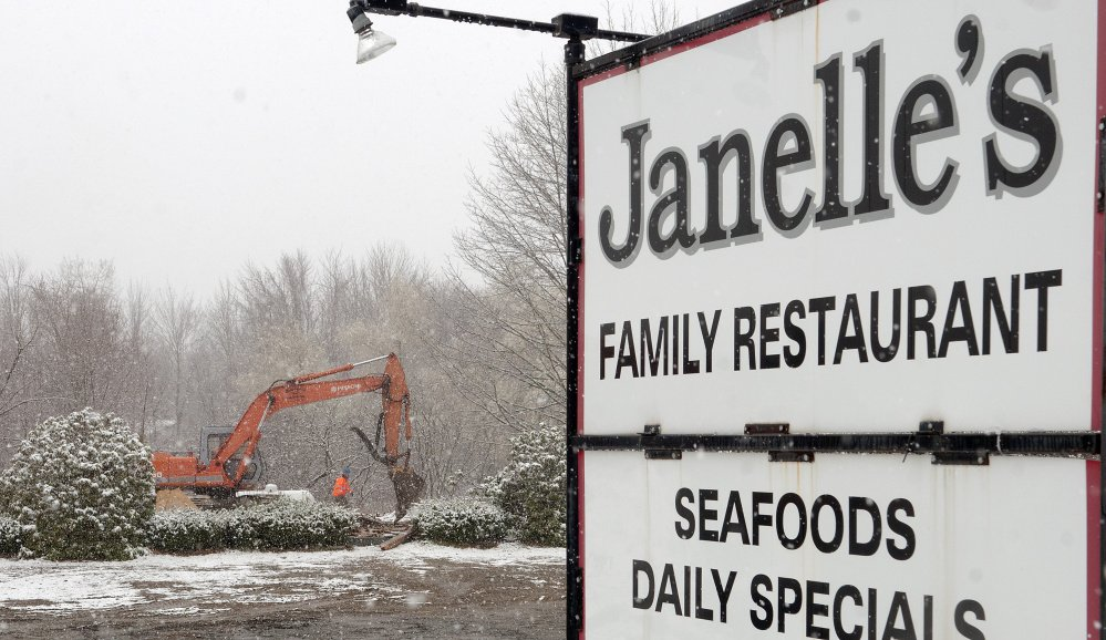 McNaughton Brothers Construction workers demolish the former Janelle's Family Restaurant in Gardiner on Tuesday. Families Matter Inc. plans to build a 3,100-square-foot, single-story office building there.