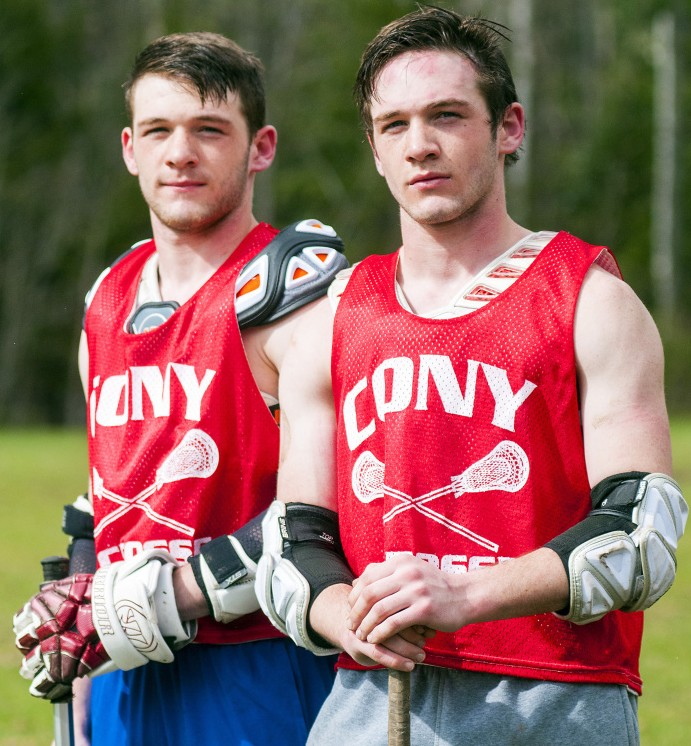 Twin brothers Tyler Sproul, left, and Bret Sproul pose during lacrosse practice Tuesday at Cony High School in Augusta.