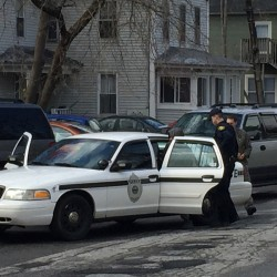 Augusta police and Maine Drug Enforcement Agency officials arrest Charles Evans, of Rochester, N.Y., on charges of drug trafficking Tuesday afternoon on Middle Street in Augusta.
