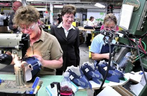 Sen. Susan Collins toured the New Balance factory in Norridgewock several years ago to see how footware is made and speak with employees including Gail Fenlason at left. Collins later received an award for her legislative work with the manufacturing industry.