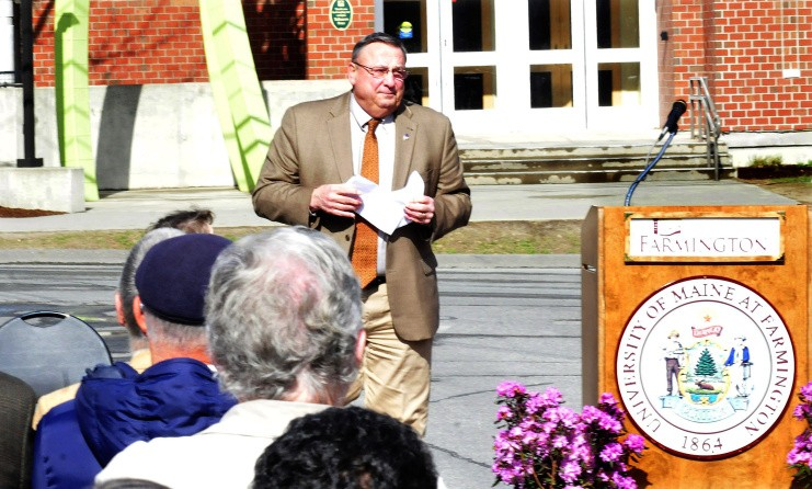 Gov. Paul LePage steps away from the lectern Tuesday while speaking during a dedication of the Theodora J. Kalikow Education Center at the University of Maine in Farmington after students held up signs criticizing him.