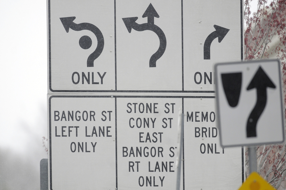 A directional sign on Tuesday at Cony Circle in Augusta.
