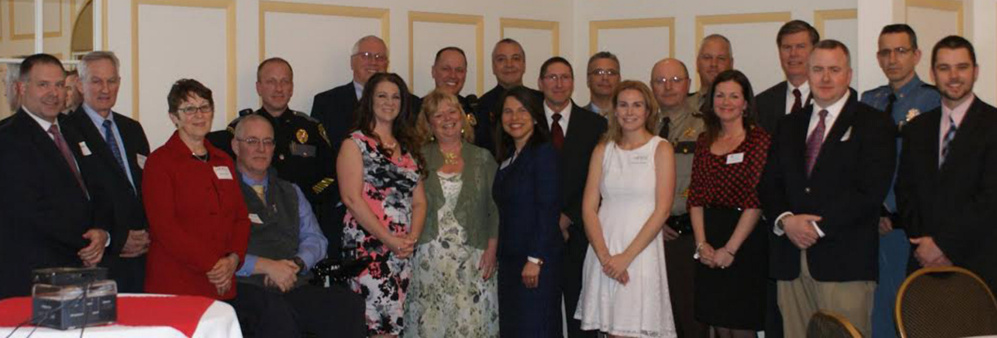 In front, from left, are Jenna McCarthy Mayhew, Donna Strickler, District Attorney Maeghan Maloney, Samantha Marquis, Michelle Galego, Deputy Chief Charles Rumsey and James Martin. In back, from left, are Dale Hamilton, Tom McAdam, Melody Fitch, Chief Robert Gregoire, Chief Craig Johnson, Chief Joseph Massey, Chief Ryan Frost, Chief James Toman, Chief Michael Tracy, Chief Shawn O'Leary, Sheriff Dale Lancaster, Sheriff Ryan Reardon, Chuck Hayes and Lt. Col. John Cote.