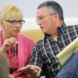 Benton residents Sue and Doug Blaisdell discuss testimony Wednesday before a hearing officer at the Maine Public Utility Commission in Hallowell about noise emanating from a Central Maine Power substation in Benton.