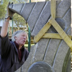 "Sculptor Bill Royall installs ""Galaxy,"" a carved stone sculpture, on Wednesday at Johnson Park in Gardiner."