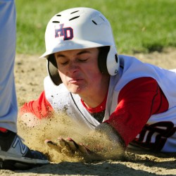 Hall-Dale baserunner Jordan Gardner dives back to the base in time on a pick-off play Wednesday at Hall-Dale High School in Farmingdale.
