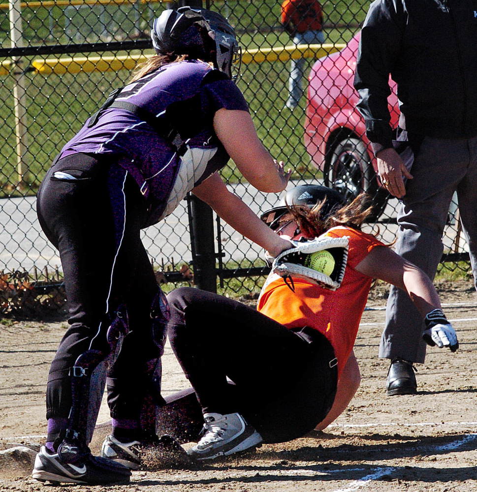 Waterville catcher Coby Dangler attempts to tag out Gardiner's Maddie Curran at home plate during game Wednesday in Waterville.