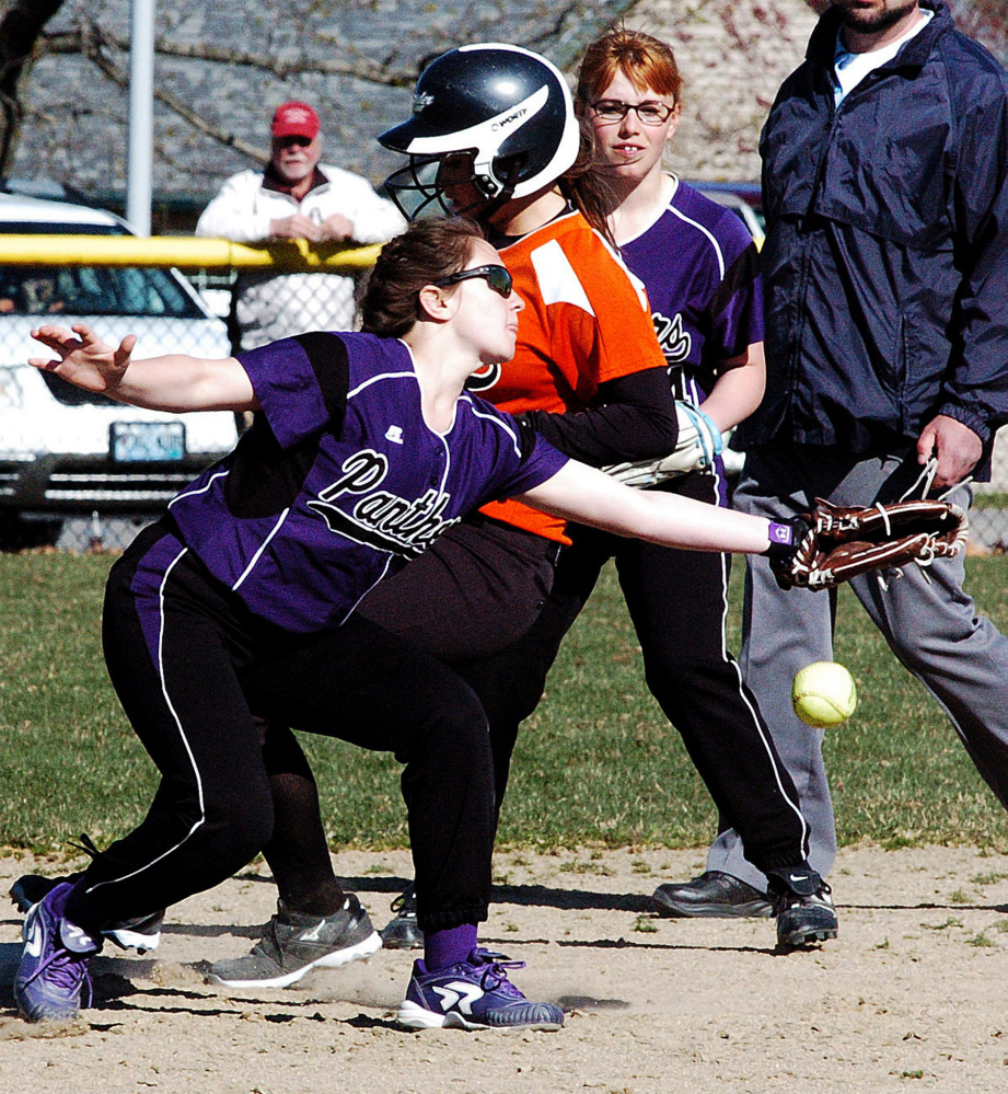 Gardiner's Bri Brochu makes it to second base as Waterville's Shelby Place attempts to tag her out Wednesda in Waterville. Rebecca Oakes backs up the play.