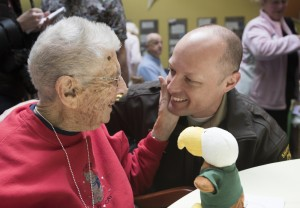 Clara Swan greets a nephew, Will Sheehan, at Husson University on Thursday.